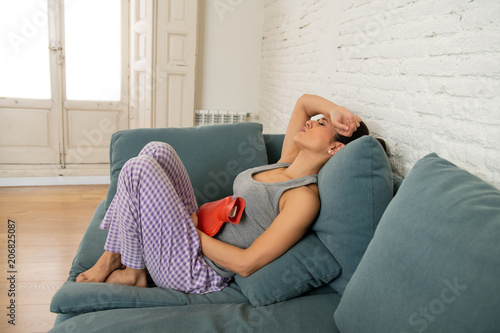 Young sad attractive woman having painful stomachache from period pain and menst Tableau sur Toile