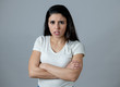 Human expressions and emotions. Young attractive woman with an angry face, looking furious and upset