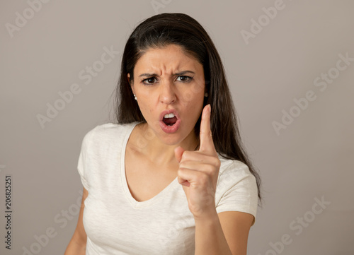 Human expressions and emotions. Young attractive woman with an angry face, looking furious and crazy