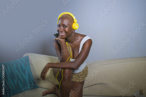 Poster  young happy and beautiful relaxed black afro American woman listening to music w