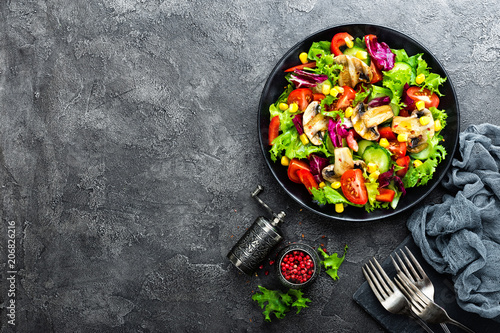 Garden Poster Personal Salad with fresh and grilled vegetables and mushrooms. Vegetable salad with grilled champignons. Vegetable salad on plate. Healthy vegetarian food