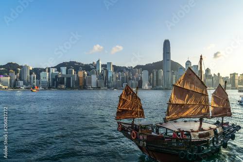 sailboat with city skyline in hongkong china Poster