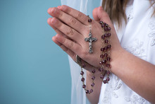 Communion Girl With Praying Hands With Rosary Beads