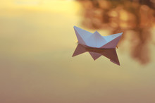 Paper Origami Boat Floats On T...