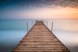 sunset pier wit clouds in the sea of minimalism
