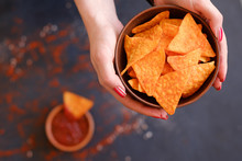 Homemade Fried Tortilla Nacho Chips. Delicious Salty Food Snack. Woman Hands Holding A Bowl With Crunchy Spicy Triangular Crisps