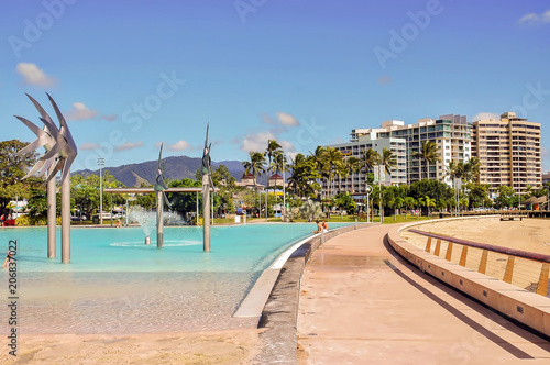 View of public pool and coastal buildings in Cairns, Australia. Wallpaper Mural
