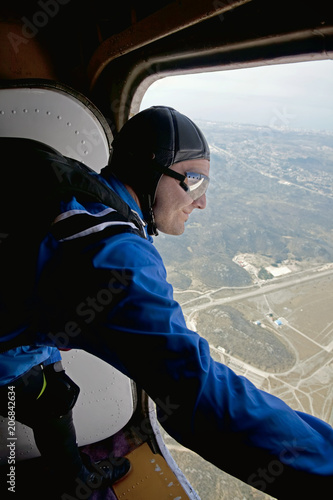 Parachutist before jump from a plane