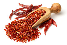 Dried Red Pepper Flakes In The Olive Wooden Scoop, Isolated On White