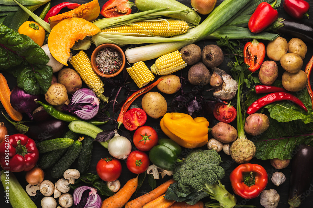 Heap of fresh vegetables on wooden background with copy space