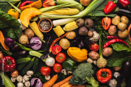 Tuinposter Groenten Heap of fresh vegetables on wooden background with copy space