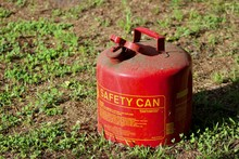 Dusty Red Gas Can On Grass