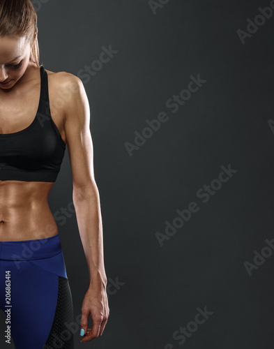 Image of fitness woman in sports clothing looking down