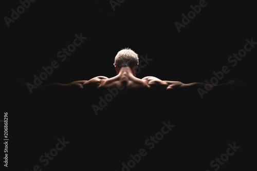 Fotografie, Obraz  Handsome power athletic man in dramatic light