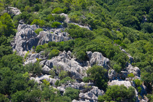 Rock Formations With Vertical Striations On A Hillside In Mallorca, Spain.