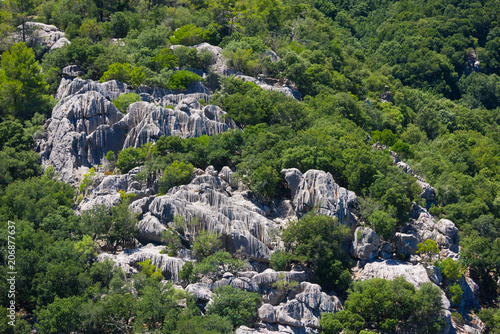 Valokuva  Rock formations with vertical striations on a hillside in Mallorca, Spain