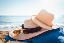 Sun Hats And Glasses On Beach ...