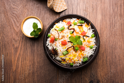 Indian Vegetable Pulav or Biryani made using Basmati Rice, served in a ceramic bowl Canvas Print