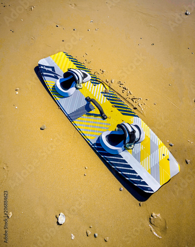 Kitesurf Board in the sand at the beach.