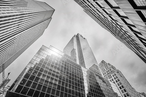 Fotobehang New York City Looking up at Manhattan skyscrapers, New York City, USA.