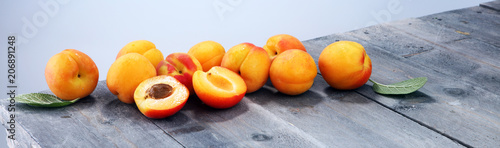 Delicious ripe apricots on wooden table. Fresh cut apricot fruits Fototapete
