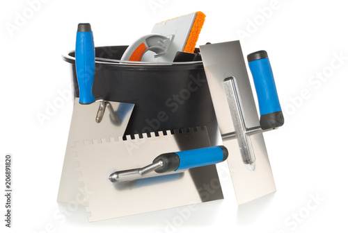 Masonry tools - trowels, notched trowel and mortar bucket - on white Canvas Print