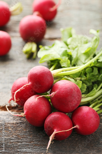 Red radishes on grey wooden table