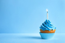 Delicious Birthday Cupcake With Candle On Color Background
