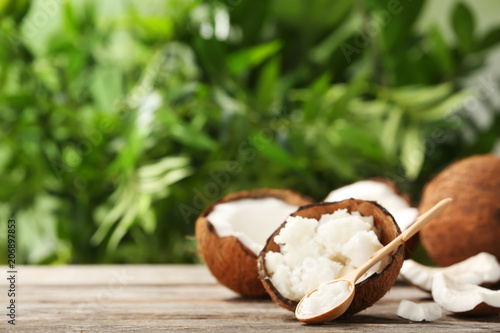Composition with coconut oil on table against blurred background. Healthy cooking