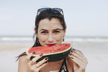Woman Eating Watermelon At The...