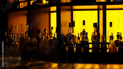 Photo sur Aluminium Cocktail amber backlit generic bar bottles