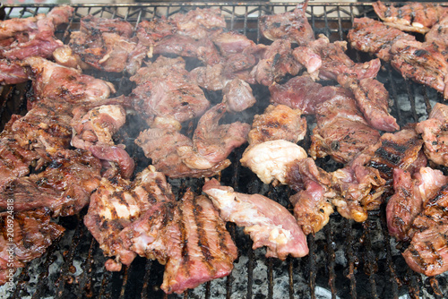 Foto op Canvas Grill / Barbecue BBQ beef and lamb meat roasted on the hot flaming charcoal grill, top view close up