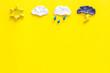 Leinwandbild Motiv Weather forecast concept. Modern weather icons set on yellow background top view copy space