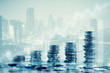 Double exposure of city and rows of coins for finance and business concept