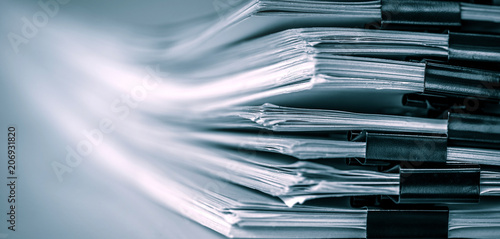 extreamely close up report paper stacking of office working document , retro color tone