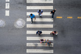 Aerial photo top view of people walk on street in the city over pedestrian crossing traffic road