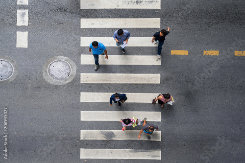 Canvastavla Aerial photo top view of people walk on street in the city over pedestrian cross