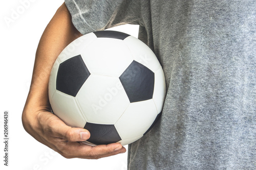 Fotobehang Bol The hand holds the ball at the waist, Background