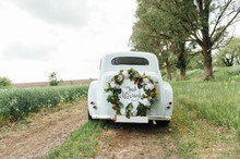 Beautiful Wedding Car With Pla...