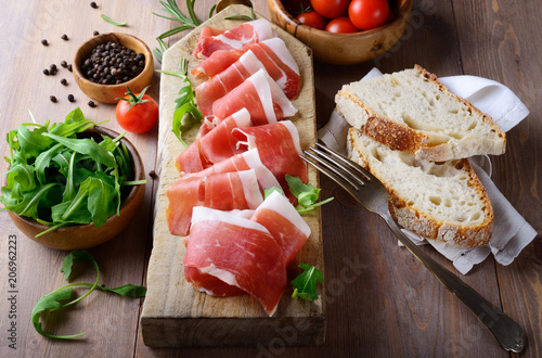 Fotobehang Assortiment Tray with raw ham, italian prosciutto crudo