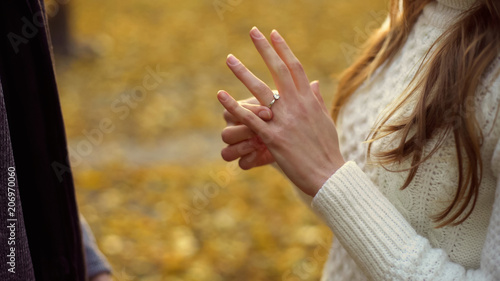 Photo Lady trying on engagement ring gifted by boyfriend, precious gift, betrothal