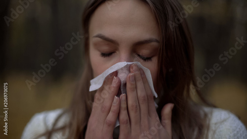 Valokuva  Woman suffering from runny nose, poor immunity in cold weather season, health