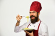 Chef eats italian or asian noodles. Cook with happy face