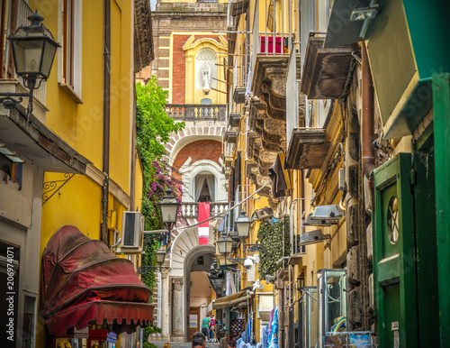 Photo Stands Napels Narrow alley with Duomo steeple on the background in Sorrento