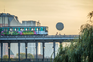 Aerial metro on Bir Hakeim bridge at sunset in Paris France
