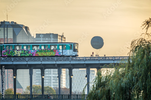 Aerial metro on Bir Hakeim bridge at sunset in Paris France - 206974874