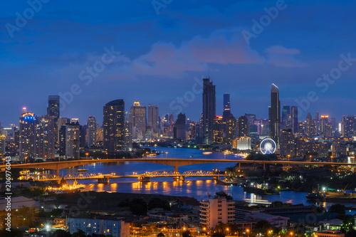 Foto op Canvas Texas Bangkok and Rama 3 Bridge. Skyscraper buildings at Chao Phraya River in Bangkok City at night, Thailand.