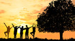 Silhouetted photo.They are standing with big tree and show hand together.They are enjoying and also they are watching the evening glow together. They are happy in good time. Photo concept for Silhoue