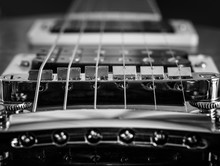 Electric Guitar Elements, Strings, Pickups Black And White Macro.