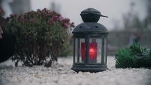Red Candle Lantern On The Grav...